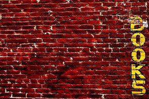 brick wall with book graffiti