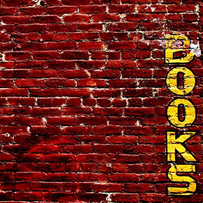 brick wall with book graffiti