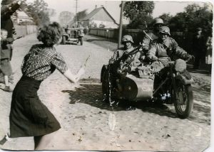 Ukranian woman and a boy welcome soldiers of the German Wehrmacht 1941 | Literary Field Kaleidoscope