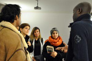 Musa Okwonga talking to students
