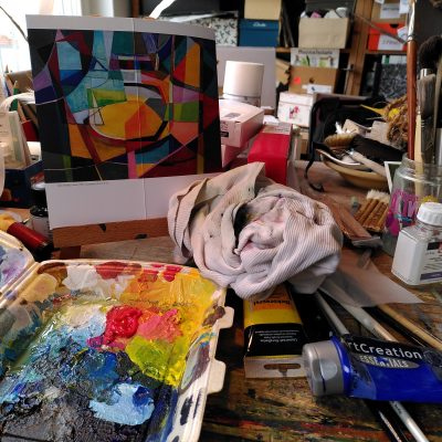 Image of a desk with painting materials